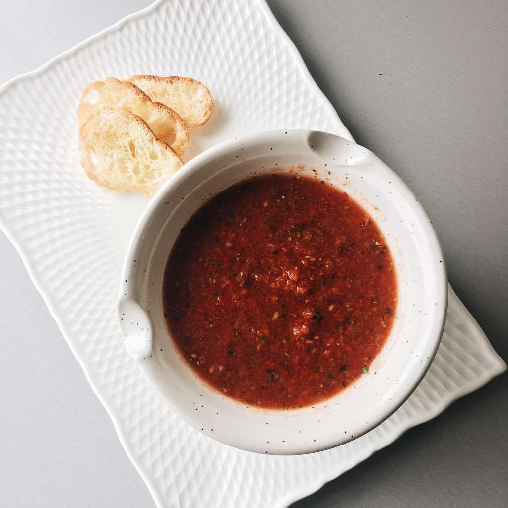 Gazpacho soup with crostini.
